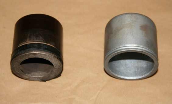 Here you can see the phenolic piston on the left and the steel piston on the right.